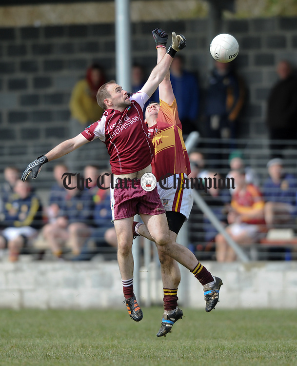 Oisin Talty of Lissycasey in action against Micheal malone of St Joseph's Miltown Malbay during their Cusack Cup first round game at Lissycasey. Photograph by John Kelly.