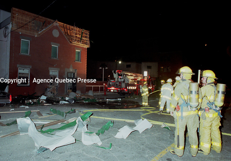 File Photo<br /> Firemen look at the remain of a bikers bunker on de Bordeaux Street in East End Montreal, CANADA  after a rival gang set up a bomb that destroyed part of the building , October 1st, 1995 <br /> <br /> Photo by Pierre Roussel - IMAGES DISTRIBUTION