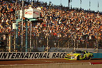 Nov 13, 2005; Phoenix, Ariz, USA;  Nascar Nextel Cup driver Kyle Busch driver of the #5 Kellogs Chevy crosses the finish line to take the victory in the Checker Auto Parts 500 at Phoenix International Raceway. Mandatory Credit: Photo By Mark J. Rebilas