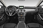Stock photo of straight dashboard view of2015 Mercedes Benz GLA 250 4Matic Exclusiefpakket 5 Door SUV Dashboard