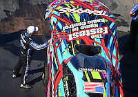 Jun 17, 2016; Bristol, TN, USA; NHRA funny car driver John Force stands alongside the car of daughter Courtney Force during qualifying for the Thunder Valley Nationals at Bristol Dragway. Mandatory Credit: Mark J. Rebilas-USA TODAY Sports