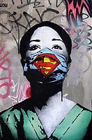 Nederland Amsterdam- juni 2020.  Super Nurse.  De straatkunstenaar Fake maakte een kunstwerk van een verpleegkundige als Superwoman op de NDSM-werf in Noord.  Foto ANP / Hollandse Hoogte / Berlinda van Dam