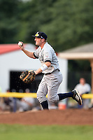 Staten Island Yankees first baseman Connor Spencer (56) chases down a runner in a run down during a game against the Batavia Muckdogs on August 7, 2014 at Dwyer Stadium in Batavia, New York.  Staten Island defeated Batavia 2-1.  (Mike Janes/Four Seam Images)