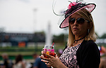LOUISVILLE, KY - MAY 03: A woman drinks an Oaks Lily and wears a matching pink hat during Thurby at Churchill Downs on May 3, 2018 in Louisville, Kentucky. (Photo by Scott Serio/Eclipse Sportswire/Getty Images)