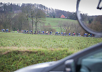 While the peloton is already in descend mode, the team cars still climbing up the Goeberg<br /> <br /> 1st Dwars door West-Vlaanderen 2017 (1.1)