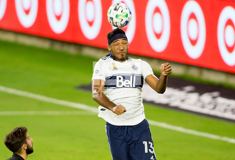 LOS ANGELES, CA - SEPTEMBER 23: Derek Cornelius #13 of the Vancouver Whitecaps heads a ball during a game between Vancouver Whitecaps and Los Angeles FC at Banc of California Stadium on September 23, 2020 in Los Angeles, California.