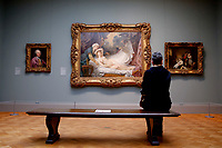 NEW YORK, NEW YORK - MARCH 19: A woman takes a look of art works at The MET Museum on March 19, 2021 in New York. The Met Museum is considering selling some of its works to support itself after claming that the pandemic has caused a loss of revenue of $150 million in about 18 months. (Photo by John Smith/VIEWpress)