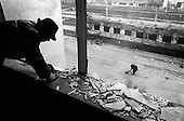 Grozny, Chechyna.1995.A man and a woman begin the task of cleaning  up their office near the train station. They do this not because there is any business but just to have something to do.