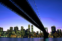 Scenic cityscape of Manhattan with the Brooklyn Bridge in the foreground. New York, New York.