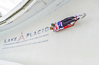 5 December 2014:  Justin Krewson and Tristan Jeskanen, sliding for the USA, bank into Curve 10 on their second run, ending the day with a 13th place finish and a combined 2-run time of 1:29.189 in the Men's Doubles Competition at the Viessmann Luge World Cup, at the Olympic Sports Track in Lake Placid, New York, USA. Mandatory Credit: Ed Wolfstein Photo *** RAW (NEF) Image File Available ***