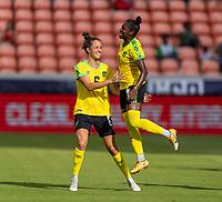 HOUSTON, TX - JUNE 10: Havana Solaun #6 celebrates with Deneisha Blackwood #14 of Jamaica during a game between Nigeria and Jamaica at BBVA Stadium on June 10, 2021 in Houston, Texas.