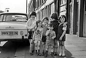 1975: children outside boarded-up shops, since demolished, in Kensal Road, North Kensington.