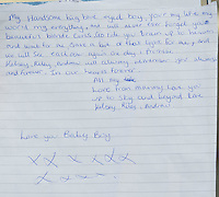 Pictured: A hand-written tribute left by Jennifer (Jenny) Davies for her son Jac Davies who died in a house fire in the Alltwen area of Pontardawe, south Wales. Wednesday 27 July 2016<br /> Re: A four-year-old boy has died following a fire at a house in Neath Port Talbot.<br /> Fire crews were called to the property in Lon Tanyrallt, Alltwen, near Pontardawe, at 1.40am on Wednesday.<br /> They rescued the boy from an upstairs bedroom in the two-storey semi-detached house but he died at the scene.<br /> A three-year-old boy was also rescued and take to hospital along with his sister, six, and mother who had both managed to escape the blaze.<br /> They were all suffering from suspected smoke inhalation.<br /> Mid and West Wales Fire and Rescue Service said the woman, who is believed to be in her 20s, called for help and neighbours tried to get in to help the stranded children.