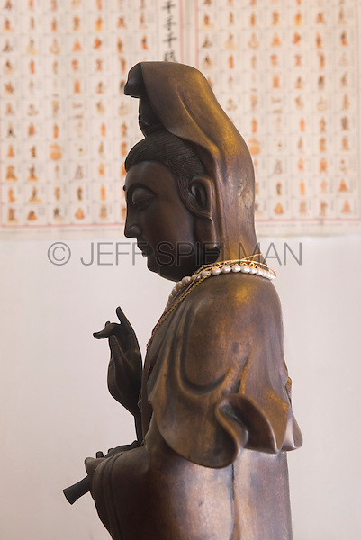 AVAILABLE FROM JEFF AS A FINE ART PRINT.<br /> <br /> AVAILABLE FROM GETTY IMAGES FOR COMMERCIAL and EDITORIAL LICENSING.  Please go to www.gettyimages.com and search for image #102093175.<br /> <br /> Statue of Buddhist Goddess Quan Yin, in a Chinese Buddhist Temple<br /> <br /> Eldridge Street, Chinatown, Lower Manhattan, New York City, New York State, USA