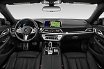 Stock photo of straight dashboard view of 2020 BMW 7-Series M-Sport 4 Door Sedan Dashboard