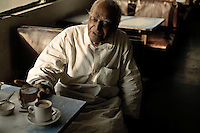 An elderly man in the Indian coffee house, Baba Kharak Singh Marg. The coffee house dates back almost fifty years, first in central Connaught Place, then Janpath and now at the top of a rather shabby shopping centre. It is still run by the Indian Coffee Workers Cooperative Society. Once a regular haunt for politicos in Delhi, its clientele is still renowned for being well-read and intellectual.