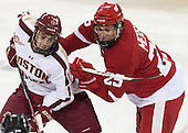 Johnny Gaudreau (BC - 13), Michael Mersch (Wisconsin - 25) - The Boston College Eagles defeated the visiting University of Wisconsin Badgers 9-2 on Friday, October 18, 2013, at Kelley Rink in Conte Forum in Chestnut Hill, Massachusetts.