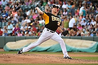 Jarrett Grube (39) of the Salt Lake Bees delivers a pitch to the plate against the Reno Aces in Pacific Coast League action at Smith's Ballpark on July 23, 2014 in Salt Lake City, Utah.  (Stephen Smith/Four Seam Images)
