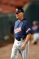 Gwinnett Braves manager Brian Snitker (4) walks to the dugout in between innings during a game against the Buffalo Bisons on May 13, 2014 at Coca-Cola Field in Buffalo, New  York.  Gwinnett defeated Buffalo 3-2.  (Mike Janes/Four Seam Images)