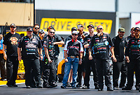 Jul 29, 2018; Sonoma, CA, USA; NHRA top fuel driver Steve Torrence (center) stands with crew members for Scott Palmer during the Sonoma Nationals at Sonoma Raceway. Mandatory Credit: Mark J. Rebilas-USA TODAY Sports