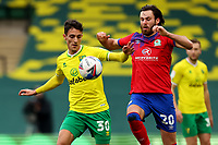 20th March 2021; Carrow Road, Norwich, Norfolk, England, English Football League Championship Football, Norwich versus Blackburn Rovers; Dimitris Giannoulis of Norwich City competes for the ball with Ben Brereton of Blackburn Rovers