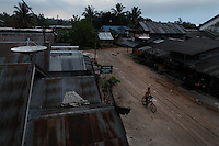 "East Java has high unemployment and there are many migrant workers on Kalimantan (Borneo) from Java who came initially to do artisanal timber work.  The government stomped out the little guys in timber in favor of two big companies so they could control (read ""profit from"") the industry.  So all the artisanal timber workers switched to gold. Karang Pani is a new regency established by the government--The town is only 3 years old and is support center for the artisanals--providing diesel engines, retorts to purify amalgam and other services.  The gold mining area is called Galangan and is about 11KM out of town. There are 15 retorts in Karang Pani and the mercury goes up in the smoke but then rains down on the town.  Miners test in the 1000 plus area for ppm of mercury--normal is 170 to 300 depending on how many mercury fillings you have (results of Unido testing in area).  Miners earn about $5USD a day.  E. Java is way overcrowded and the govt. has an official transmigration program over to Kalimantan.  In E. Java they can earn about 100RP a day hoeing the fields, here they can earn upwards of 30,000-60,000RP ($3-$6) a day. So it is worth it to them to camp in this area having only the water from the amalgam ponds to bath and drink.  I have many photos of people brushing their teeth or bathing next to a guy panning with a big glob of mercury."