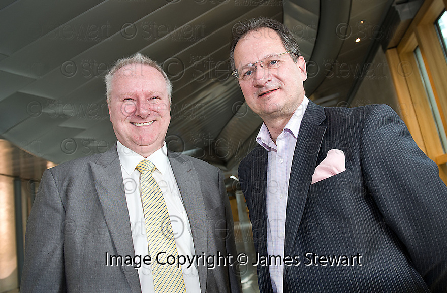 Cabinet Secretary for Infrastructure and Capital Investment, Alex Neil MSP (left),  with Graeme Ross, Business Development Director, BMI Regional, at the announcement of the sale of BMI Regional's sale from IAG to Sector Aviation  Holdings (SAH) .............31/05/2012    jsp006_bmi   .Copyright  Pic : James Stewart.James Stewart Photography 19 Carronlea Drive, Falkirk. FK2 8DN      Vat Reg No. 607 6932 25.Telephone      : +44 (0)1324 570291 .Mobile              : +44 (0)7721 416997.E-mail  :  jim@jspa.co.uk.If you require further information then contact Jim Stewart on any of the numbers above........