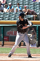 Travis Ishikawa (16) of the Fresno Grizzlies at bat against the Salt Lake Bees at Smith's Ballpark on May 26, 2014 in Salt Lake City, Utah.  (Stephen Smith/Four Seam Images)