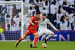 Pablo Sarabia Garcia of Sevilla FC (L) fights for the ball with Nacho Fernandez of Real Madrid (R) action during La Liga 2017-18 match between Real Madrid and Sevilla FC at Santiago Bernabeu Stadium on 09 December 2017 in Madrid, Spain. Photo by Diego Souto / Power Sport Images