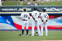 (L-R) Scranton/Wilkes-Barre RailRiders outfielders Thomas Milone (19), Socrates Brito (7), and Frederick Cuevas (12) stand for the National Anthem prior to the game against the Rochester Red Wings at PNC Field on July 25, 2021 in Moosic, Pennsylvania. (Brian Westerholt/Four Seam Images)