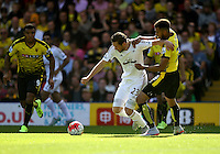 Gylfi Sigurosson of Swansea battles with Etienne Capoue of Watford    during the Barclays Premier League match Watford and Swansea   played at Vicarage Road Stadium , Watford