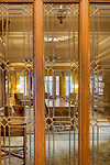 Elegant library viewed through leaded glass doors, historic building.  Dating to 1927, the Masonic Retirement Center, locally known as the Masonic Home, in Des Moines, Washington is now an elegant event center available for rental.  In the historic Zenith neighborhood of the city of Des Moines. Please conact douglasorton@comcast.net regarding licensing of this image.