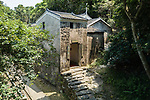 The gated watch tower of Sheung Yiu Village, Sai Kung. A fortified Hakka village built on raised ground in around 1850.