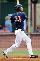 Elizabethton Twins first baseman Rory Rhodes #33 swings at a pitch during a game against the Greenville Astros at Joe O'Brien Field on August 21, 2012 in Elizabethton, Tennessee. The Twins  defeated the Astros 7-5 (Tony Farlow/Four Seam Images).