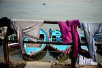 A boatman on his boat at a ghat in Varanasi, Uttar Pradesh, India.