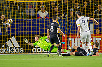 CARSON, CA - SEPTEMBER 15: Zlatan Ibrahimovic #9 of the Los Angeles Galaxy takes a scoring shot on goal past Graham Zusi #8, Graham Smith #16 and Tim Melia #29 during a game between Sporting Kansas City and Los Angeles Galaxy at Dignity Health Sports Park on September 15, 2019 in Carson, California.