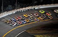 Feb 07, 2009; Daytona Beach, FL, USA; NASCAR Sprint Cup Series driver Dale Earnhardt Jr (88) and Elliott Sadler (19) race side by side for the lead during the Bud Shootout at Daytona International Speedway. Mandatory Credit: Mark J. Rebilas-