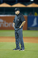 Umpire Kelvis Velez handles the calls on the bases during the South Atlantic League game between the Augusta GreenJackets and the Greensboro Grasshoppers at First National Bank Field on April 10, 2018 in Greensboro, North Carolina.  The GreenJackets defeated the Grasshoppers 5-0.  (Brian Westerholt/Four Seam Images)
