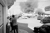 Culiacan, Sinaloa.Mexico.July 5, 2008..Adding to the drug related violence is arson created fires of cartel businesses. The often burn the other cartels shops. From January 1 to mid-July 2008 there have been 535 drug related killings in Sinolao, many of them were police officers..