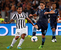 Calcio, Supercoppa di Lega: Juventus vs Lazio. Roma, stadio Olimpico, 18 agosto 2013<br /> Juventus forward Carlos Tevez, of Argentina, left, and Lazio midfielder Lucas Biglia, of Argentina, fight for the ball during the Italian League Supercup football final match between Juventus and Lazio, at Rome's Olympic stadium,  18 August 2013.<br /> UPDATE IMAGES PRESS/Riccardo De Luca