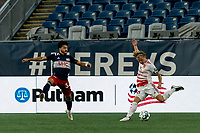 FOXBOROUGH, MA - AUGUST 21: Ryley Kraft #98 of Richmond Kickers takes a shot as Ryan Spaulding #34 of New England Revolution II defends during a game between Richmond Kickers and New England Revolution II at Gillette Stadium on August 21, 2020 in Foxborough, Massachusetts.