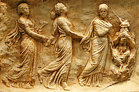 Marble votive relief with the three Nymphs or Hours, deities of the Seasons, dance to the sound of the pipes played by Pan (330-320 B.C.) in National Museum, Greece