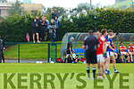 Spa players look on as the referee talks to Rathmore's Paul Murphy during their IFC clash in Killarney Friday evening