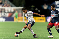 FOXBOROUGH, MA - AUGUST 18: Yamil Asad #11 of D.C. United dribbles as DeJuan Jones #24 of New England Revolution closes during a game between D.C. United and New England Revolution at Gillette Stadium on August 18, 2021 in Foxborough, Massachusetts.