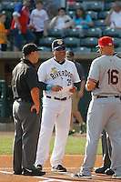 Charleston RiverDogs manager Luis Dorante (25) meeting at the plate before a game against the Hickory Crawdads at Joseph P. Riley Jr. Ballpark on May 2, 2015 in Charleston, South Carolina. Hickory defeated Charleston 4-1. (Robert Gurganus/Four Seam Images)