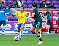 ORLANDO, FL - FEBRUARY 18: Debinha #9 of Brazil dribbles during a game between Argentina and Brazil at Exploria Stadium on February 18, 2021 in Orlando, Florida.