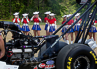 Apr 22, 2014; Kilgore, TX, USA; Kilgore College Rangerettes look on as NHRA top fuel dragster driver Steve Torrence warms up his car at the Torrence estate. Mandatory Credit: Mark J. Rebilas-USA TODAY Sports