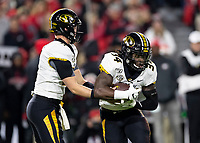 ATHENS, GA - NOVEMBER 09: Kelly Bryant #7 of the Missouri Tigers hands the ball of to running back Larry Rountree III #34 during a game between Missouri Tigers and Georgia Bulldogs at Sanford Stadium on November 09, 2019 in Athens, Georgia.