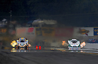 Oct. 1, 2011; Mohnton, PA, USA: NHRA funny car driver Mike Neff (right) races alongside Jim Head during qualifying for the Auto Plus Nationals at Maple Grove Raceway. Mandatory Credit: Mark J. Rebilas-