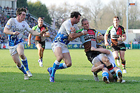 Mike Brown of Harlequins is tackled by Matt Carraro (left) and Dan Hipkiss of Bath Rugby during the Aviva Premiership match between Harlequins and Bath Rugby at The Twickenham Stoop on Saturday 24th March 2012 (Photo by Rob Munro)